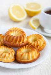 Homemade lemon cakes on white wooden table, selective focus