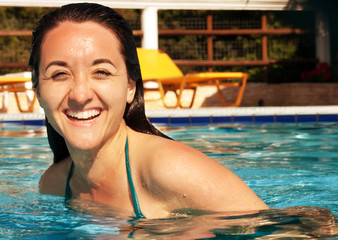 woman smiling in a swimming pool