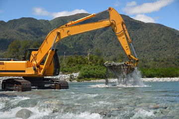 digger in the river