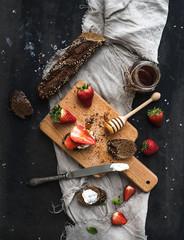 Breakfast set. Black baguette toasts with fresh strawberries