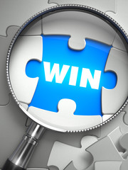 Win - Missing Puzzle Piece through Magnifier.