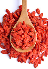 dry red goji berries  in the spoon on white background