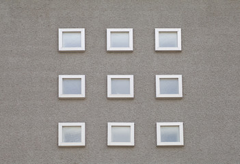 Detail of house exterior wall and window.