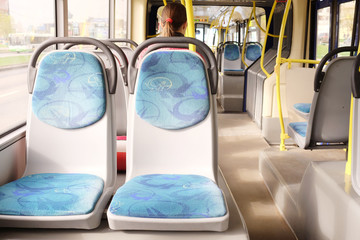 Handles for standing passengers inside a bus