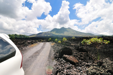 driving across the caldera ridge road among crater of the volcan