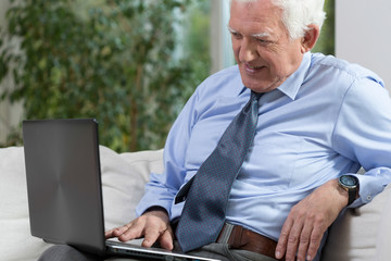 Senior man with a laptop