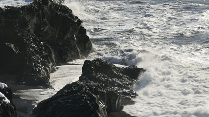 Waves crashing on rock coast