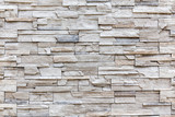 Fototapety Exterior rock brick wall, background wall pattern.