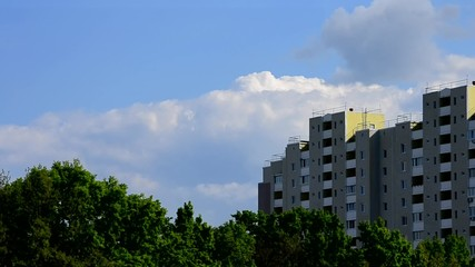 Beautiful clouds move behind modern high rise building