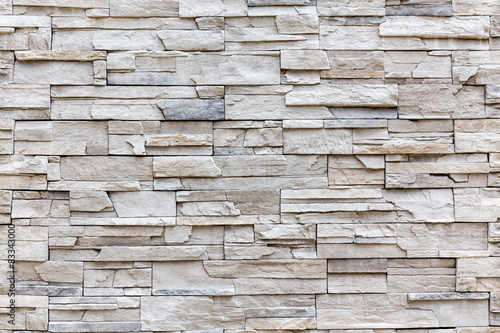 Fototapeta Exterior rock brick wall, background wall pattern.