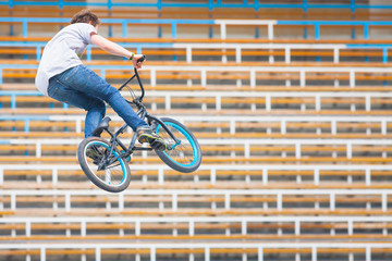teenager on a bicycle in a high jump
