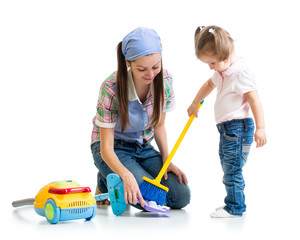 Child girl and mom cleaning room