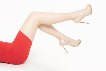 Woman legs with high heels shoes on white, clipping path
