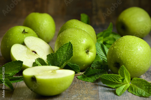 Green apples with mint leaves.