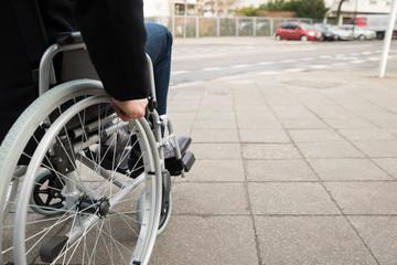 Man Sitting On Wheelchair