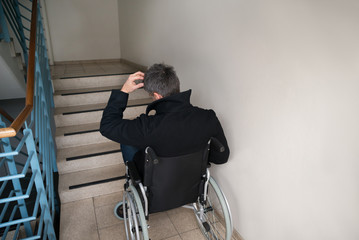 Worried Disabled Man In Front Of Staircase
