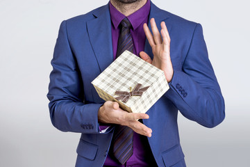 Businessman showing a gift box