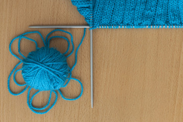 ball and spokes on a knitted background
