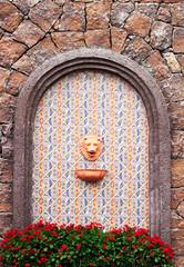 fountain in mosaic wall