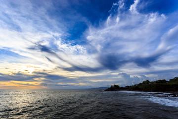 Tahah Lot Temple and ocean waves at sunset, Bali