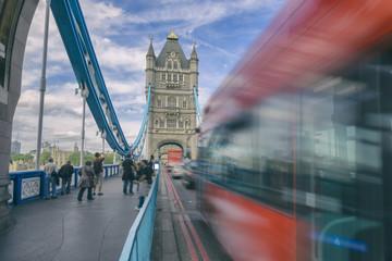 London street scene - bus speeding along bridge