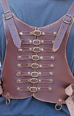 leather corset with many brass buckles