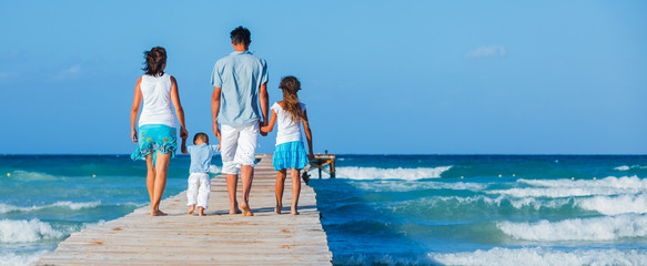 Family walking wooden jetty