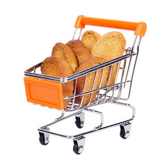 Shopping trolley with pieces of crackers. isolated on white