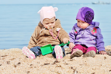 baby friends on the sea shore