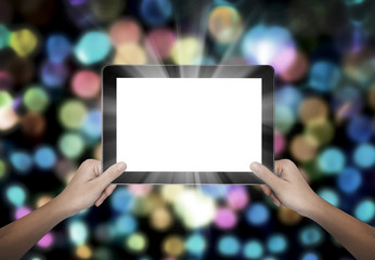 Female hand holding tablet pc on colorful bokeh background