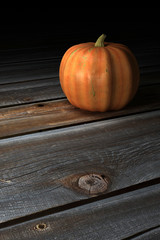 Pumpkin on wooden floor