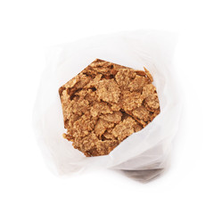 Plastic bag of cereal flakes isolated