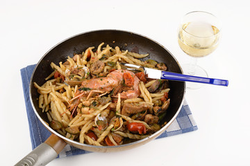 Trofie with costacei and fish in pan
