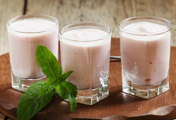 Fresh homemade yogurt berries in glasses, selective focus