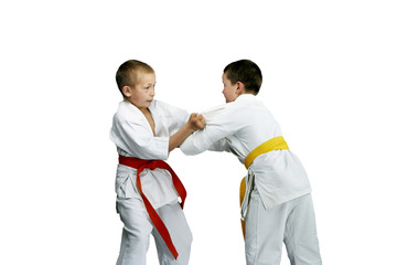 Sportsmen are doing paired exercises Judo