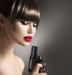 Sexy model woman with a gun. Lady with revolver