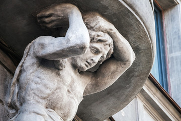 Sculpture of Atlant on facade of the old building