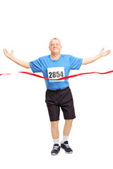 Mature runner celebrating his victory
