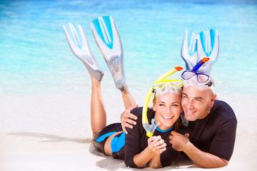 Happy couple enjoys beach activities