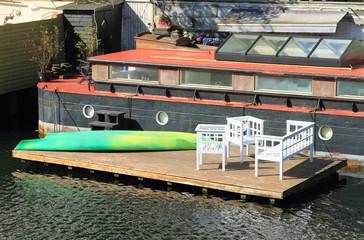 House barge with mooring. Copenhagen, Denmark