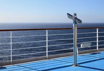 Telescope on walking deck of cruise liner