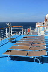 Chaise-longue on deck  of ruise liner