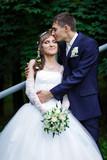 Groom kissing bride - 83370074