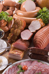 A composition of the meat, sausages and vegetables.