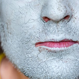 Mask of blue clay on men face