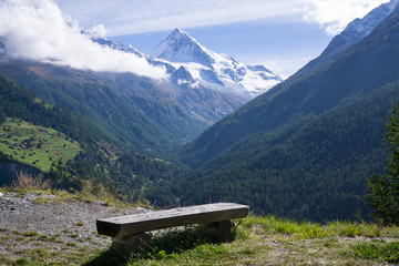 Bench with View of Mountains in the Alps, Switzerland, Valais.