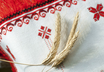 spikelets wheat on the embroidered towel