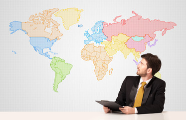 Business man with colorful world map background