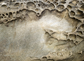 Rock erosion holes at beach