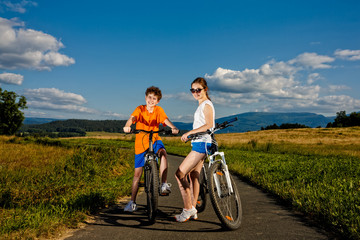 Healthy lifestyle - teenage girl and boy cycling